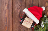 Christmas gift box with headphones and santa hat