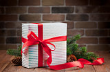 Christmas gift box and fir tree branch