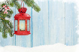 Christmas candle lantern in snow