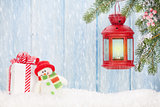 Christmas candle lantern, gift box and snowman