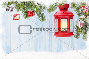 Christmas candle lantern and fir tree with decor
