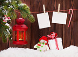 Christmas candle lantern, gift box and photos