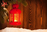 Christmas candle lantern on fir tree