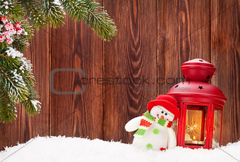 Christmas candle lantern and snowman