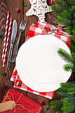 Christmas table setting with gift box and fir tree