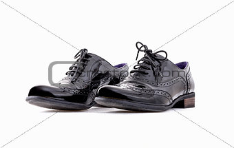 Footwear Concept. Horizontal Image. Pair of black female classic leather shoes isolated on the white background