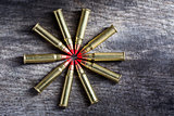 Macro shot of small-caliber tracer rounds with a red tip