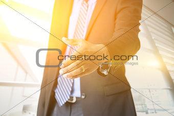 Business people hand offering handshake