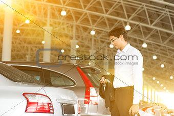 Businessman at car park