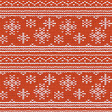 Seamless hand-knitted pattern with red and white threads.