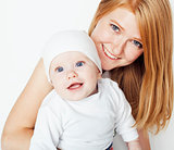 young beauty mother with baby, red head happy family isolated