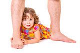 Little daughter at the feet of her father