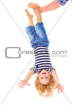 Little boy upside down