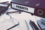 Permits on Ring Binder. Blured, Toned Image.