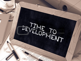 Time to Development - Inspirational Quote on Chalkboard.