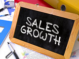 Handwritten Sales Growth on a Chalkboard.