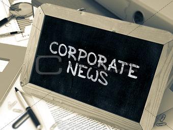 Corporate News Handwritten by White Chalk on a Blackboard.