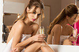 girl in bathroom with champagne