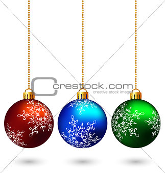 Three multicolored christmas balls isolated on white