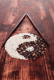 Black and white rice forming a yin yang symbol.