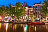 Night city view of Amsterdam canal Herengracht