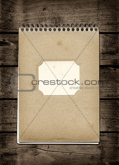 Closed spiral Note book on a dark wood table