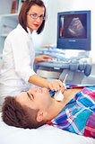 ultrasound scanning of a thyroid of man