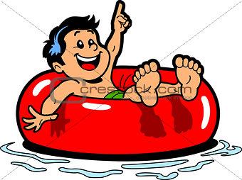 Boy Floating Inner Tube
