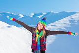 Happy woman in snowy mountains