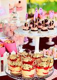 Sweet holiday buffet with cupcakes and tiramisu glasses