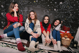 Four girlfriend on a beautiful New Year's background