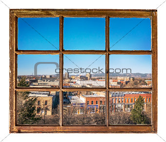 cityscape view through vintage window