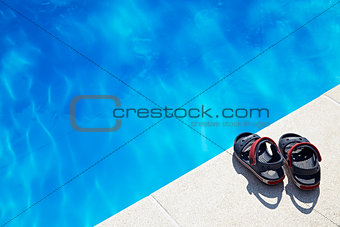 Baby sandals at the swimming pool
