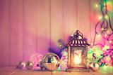 Christmas still life with lamp garland and balls