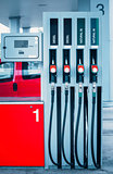 Fuel guns at gas station with petrol and diesel fuel