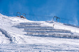 Ski lift and snow fences in Austrian Alps