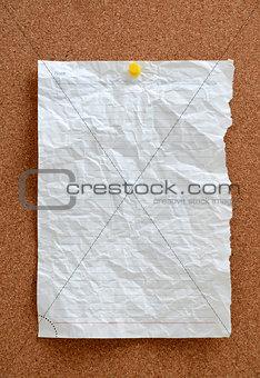 Blank piece paper pinned into corkboard