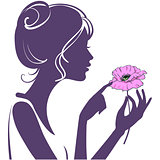 Pretty young girl with a pink poppy flower. Silhouette