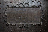 metal sign plate on old medieval door