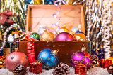 Christmas background with old wooden box and the shiny balls