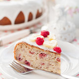 Banana Cake with Sugar Glaze Topped with Raspberries and Banana