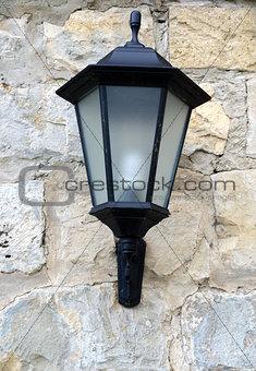 Classic lantern on stone wall