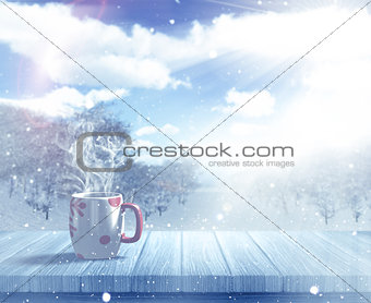 3D Christmas mug on a wooden table against a defocussed snowy la