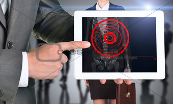Man holding tablet with x-ray of womans body