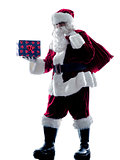 santa claus holding gifts silhouette isolated
