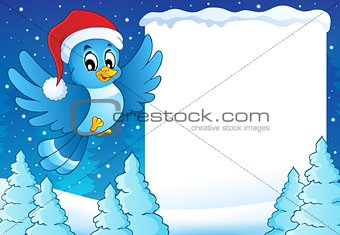 Frame with bird in Christmas hat