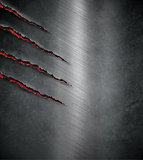 claw scratched marks on dark metal background