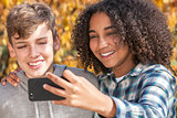 Mixed Race Teenagers Boy & African American Girl Selfie