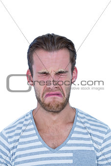 Casual man crying in front of camera