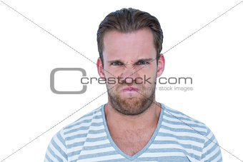 Angry casual man looking at camera